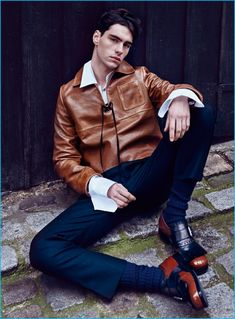 Jonathan Bauer-Hayden rocks a leather pullover from Prada's fall-winter 2016…