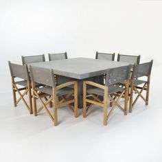 Raw Concrete Square Dining Table with 8 Beach Director Dining Chairs. $5,495