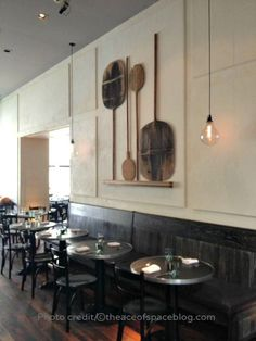 Restaurant no. 246 handblown lightbulbs, pizza paddles wall display, plaster walls-hand applied TADELAKT.
