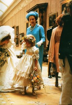 Princess Diana leaning over to console five-year-old Clementine Hambro, the great-granddaughter of Winston Churchill, after she bumped her head at the Princess' wedding, 1981