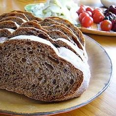 There's a nice tangy bite to this hearty dark rye that still has a tender crumb, thanks to the wheat flour. Cocoa and coffee powders darken the loaf, and caraway and fennel seeds impart just a bit of licorice flavor. It can be made in your bread machine or with a stand mixer.