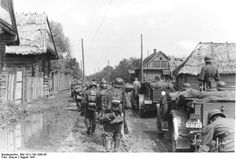 August 1941 - A column of German troops advances through a village near Minsk, Belarus.