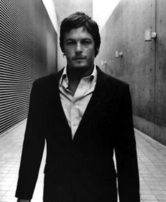 Then takes you down a shady futuristic alley. | The 23 Sexiest Pictures Of A Young Norman Reedus