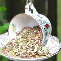 These DIY Teacup Bird Feeders are super cute and so easy to make. They are a brilliant way to use thrifted or even chipped teacups and saucers. In a world where recycling has become so important, this project also reuses your old crockery.