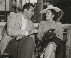 Half-Cuban actor César Romero (whose grandfather was famed Cuban poet and revolutionary José Martí) chats with Mexican actress Elena de la Cruz in Havana, 1946.