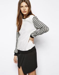 Make a statement in this gingham sweatshirt.