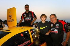 Corey and Colin Kalitta celebrate in Chicago winner's circle with their Grandfather Connie Kalitta after Jeff Arend's Funny Car victory in the late Scott Kalitta's DHL Toyota Camry.