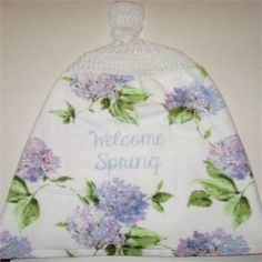 Purple flowers on this towel which welcomes spring.   This is a good quality towel and is a little thicker then most hand towels.   It says welcome spring on the towel and would add some color to your kitchen, bathroom, cabin or rv.