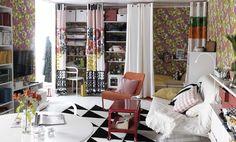 部屋が狭苦しい?花柄と明るい色のテキスタイルを使って、スペースがとても限られている部屋で、リラックスができて、仕事や食事、寝ることもできるようにしました。
