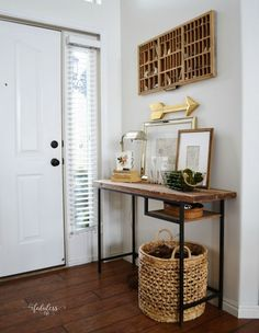 Love this farmhouse home tour done on a budget. She turned a modern Ikea desk into this rustic farmhouse table! eclecticallyvintage.com