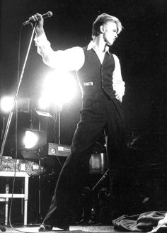 David Bowie in a waistcoat and open necked shirt with French cuffs... Gentlemen take note ;) ladies, you're welcome :)