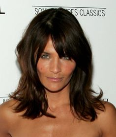 Dark brown, shoulder length hair with bangs