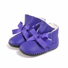 """Caroch   Anissa   Soft sole baby boots """"Anissa"""" are the cutest winter boots for baby girls! In stunning purple leather with a sweet bow! Gorgeous soft sole leather baby girls shoes from Caroch."""