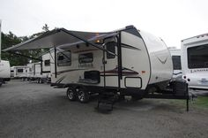 """LIGHT WEIGHT FAMILY FUN!!!  2016 Keystone Outback Terrain 210TRS At a mere 4,710 lbs and 22' 10"""" this travel trailer is a breeze to tow. The large king bed in the rear is topped with a deluxe innerspring mattress that will have you rested and ready to go in the morning. With a bunkhouse in the front and both a sofa and dinette that turn into beds, you'll have plenty of sleeping space! Give our Outback Terrain expert Scott Domont a call 231-903-6220 for pricing and more information!"""