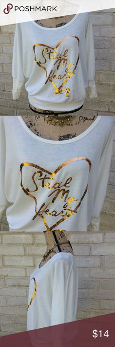 "NWT Metallic Gold Graphic Steal My Heart Top XL White quarter sleeve slouchy style shirt with rib knit cuffs and hemline.New with tags.  About a girl  brand.  Graphics are bold and ready for fall ! Tagged size XL .  Measurements :  Length 25""  20"" across front laying flat unstretched *Accessories not included*  #ravenkittystyle #slouchy #fall #fallfashion #gold #metallic #Heart #nwt #newwithtags #aboutagirl #white #tee #sizeXL About A Girl Tops Blouses"