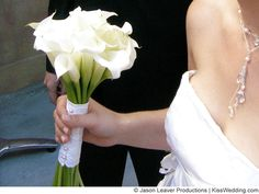 a simple white calla lily wedding bouquet