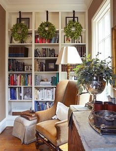 Yule style!! Noel Christmas!! Winter solstice!! Add wreaths to bookshelves!! Lovely greenery in a silver urn on the table too! Wonderful reading nook! Books, standing lamp, table, and a cozy chair! Perfect! Tis the Season - Verdigris Vie