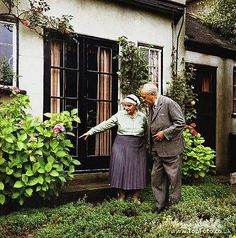 JRR TOLKIEN ;John Ronald Ruel Tolkien ;Photographed in his garden with his wife Edith at 76 Sandfield Road , Oxford ;1966 ;English writer , poet and university professor ;Credit : Pamela Chandler / ArenaPAL www.arenapal.com