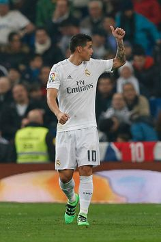 James Rodriguez of Real Madrid celebrates after scoring during the La Liga match between Real Madrid CF and Real CD Espanyol at Estadio Santiago...