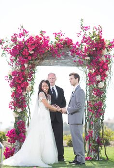 """Brides.com: Brides Live Million-Dollar Wedding: See All the Details from the Big Day!. The couple tied the knot beneath a stunning floral arbor of bright bougainvillea, fuchsia roses, and blush hydrangea overlooking the St. Regis Monarch Beach's golf course and the Pacific Ocean. The ceremony was officiated by JP Reynolds, who shared a sweet piece of advice with the couple: """"A happy marriage is a long, grand conversation that always seems too short."""""""