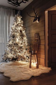 Stuning white Christmas tree all lighten up
