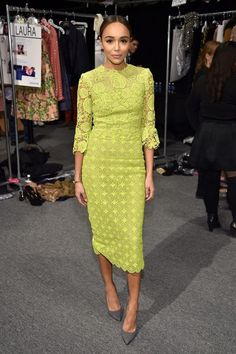 Ashley Madekwe wears a chartreuse lace midi dress with gray pumps