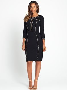 524dc8b2ef48d Give your style an edge with this studded bodycon midi dress. The long  sleeves and