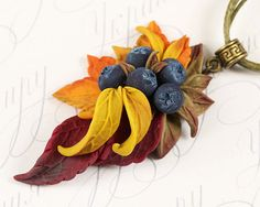 Autumn leaves blueberry necklace. Yellow red bronze fall leaves necklace. Floral berry jewellry. Polymer clay jewelry. Woodland necklace.