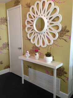Giant mirror and slim console table. This one is an Ikea Lack shelf and Godvin legs.