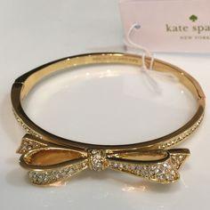 $58 Kate Spade hinge embellished gold bangle Authentic Kate Spade hinge bow gold bracelet. 14-karat gold & embellished crystals. Comes with cute little dust bag. kate spade Jewelry Bracelets