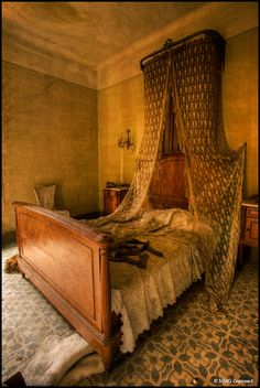 Bedroom in an abandoned castle. Where did they go? Another grand home that seems to have simply been walked out on and left behind to crumble.