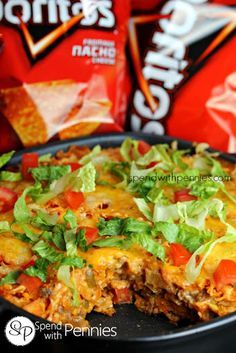 Layered Doritos Casserole! With Doritos, Onions, Lean Ground Beef, Garlic, Low Sodium Taco Seasoning, Salsa, Sour Cream, Cream Of Chicken Soup, Shredded Cheese, Lettuce, Tomatoes, Olives, Sour Cream