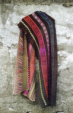 A large rectangular shawl inspired by North African embroideries, the colors of camels, the sumptuous hand-dyed gradients of Erica Heftmann's ColorShift Yarn and memories of a trip to the Atlas mountains.