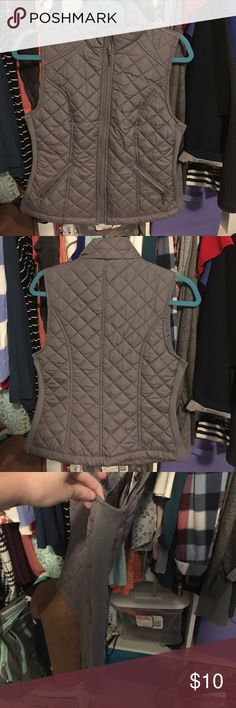 Gray Vest This gray vest has never been worn and would be super cute in the fall layered with a long sleeve shirt and some boots. It was purchased from Sears. Laura Scott Jackets & Coats Vests