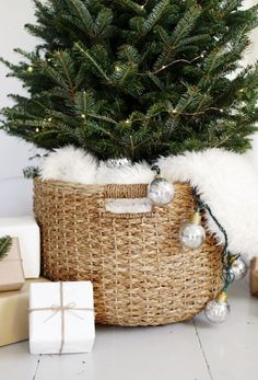 Love this luxe and cozy basket idea for a small to medium sized Christmas tree!
