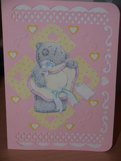 Tatty teddy on a pink card with ivory showing through the cut outs and a few hearts dotted about the place.