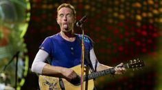 British singer-songwriter Chris Martin, frontman of British band Coldplay, performs on stage at the Arena Stadium in Amsterdam, The Netherlands, 23 June 2016, during a concert presenting their latest album 'A Head Full of Dreams'.