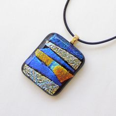 An abstract dichroic fused glass pendant