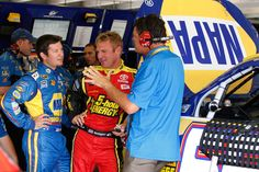 Michael Waltrip sharing some words of wisdom with his drivers Martin Truex Jr. and Clint Bowyer in the Garage Stall of the No. 56 NAPA Shocks Toyota