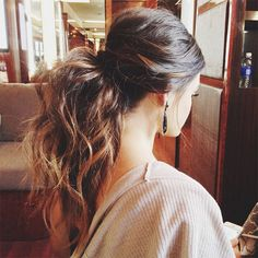Love a big messy pony!! Curl hair, add a bunch of volumizing hairspray, then haphazardly gather in ponytail. Cover the elastic with a bit of hair for added glamour.