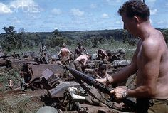 17 Oct 1969, Saigon, Vietnam --- 10/17/1969-Saigon, Vietnam- Members of the 11th Armored Cavalry in rubber plantation area at Loc Ninh and Quan Loi October 17 are shown doing various tasks, including checking their weaponry, after their arrival here. --- Image by © Bettmann/CORBIS