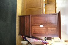 This piece would make a great coat, hat, scarf storage area in a wide entry hall - divine wooden armoire.