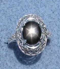 Black star sapphire ring. My favorite color stone is black....love blk sapphire, or blk diamond, or blk onyx....doesn't matter which....just think black stones are gorgeous!