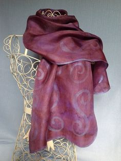 Purple and Plum Hand Painted Sparkle Silk Scarf - Hand dyed shibori patterned tie dye, mostly plum with purple, and a hyacinth blue sparkle unique wavy edge including spirals  Free postage within the UK - anywhere else the cost is to cover the postage.    NB. It was very difficult to photograph this particular scarf, and on my monitor the first photo of the scarf, matches the shade of the scarf     Long scarf - 138cm long and 40cm wide Approx.  medium weight twill woven silk, which has a…