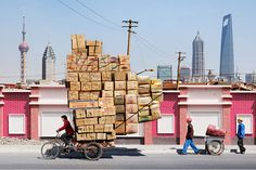 Credit: Alain Delorme Totem 16: 'I couldn't believe the sheer volume of merchandise people carried around in Shanghai, whether by bike, tricycle or trolley,' says Alain Delorme