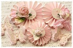 Handmade Shabby Chic Rosette Flowers with butterflies. $4.25, via Etsy.