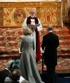 The Prince of Wales and his new bride the Duchess of Cornwall standing in front of Dr Rowan Williams, the Archbishop of Canterbury in St George's Chapel, Windsor Castle in 2005