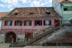 The Romania eyes: eyelid windows in the rooftops of Sibiu and other Romanian cities give the impression that someone always has their eye on you. Romania, Rooftop, Cabin, Eyes, House Styles, City, Building, Travel, Viajes