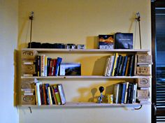 "bookcase ""avanzi"" ! only advanced parts of pallets and an old climbing rope"