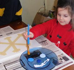 Ten kids and a Dog: A Preschool Snowflake Masterpiece